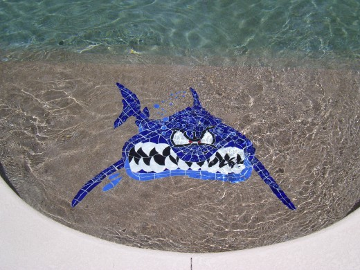 "Check out this custom swimming pool tile mosaic ""Bite Me"" shark..."