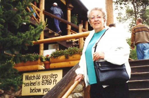 My mother on the stairs at Grandlake Lodge.