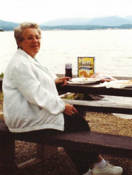 My mother at that picnic table on Lake Granby.