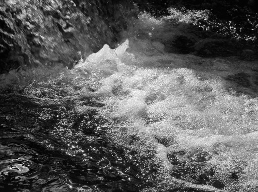 White bubbles reveal the rushing torrent due to the sudden March snow melt.