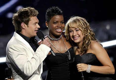 Ryan Seacrest with Season 3 winner Fantasia Barrino and runner-up Diana DeGarmo