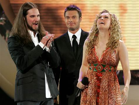 Ryan Seacrest with Season 4 winner Carrie Underwood and runner-up Bo Bice