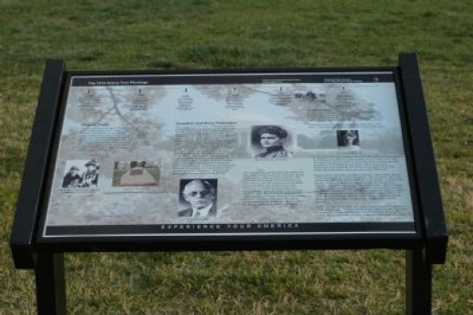 Historic marker telling the story of the cherry trees at the site of the two trees planted by Mrs. Taft.
