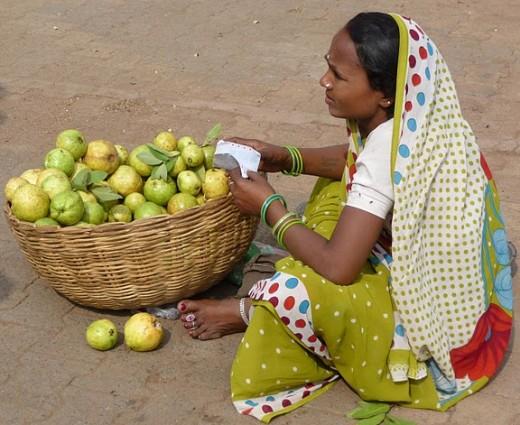 Woman pear seller in Delhi