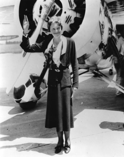 AMERLIA EARHART WITH HER LOCKHEED VEGA