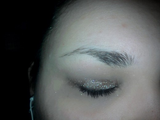 Apply the gold/brown color to your lids up to the crease.