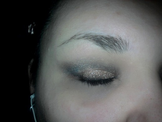 Apply the gun metal gray shadow into crease and blend up into inner corners of eye and use a fluffy brush to blend the edges.