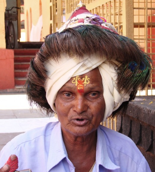 A priest with a sacred head gear