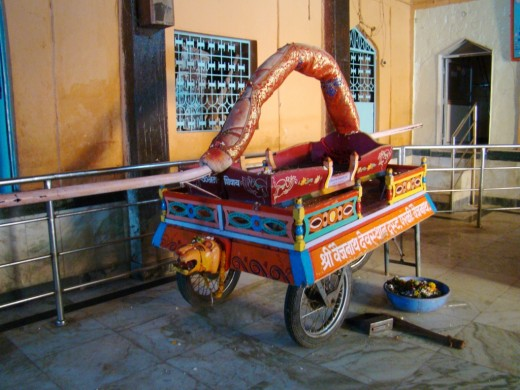 A ceremonial palanquin inside the wooden Mandap