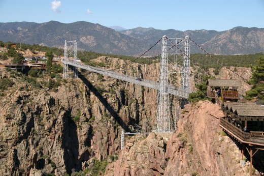 The Royal Gorge Bridge is a huge tourist attraction.  It is close to Caon-City, In Colorado,it is inside a 360 acre theme park. The deck hangs 955 feet over the Arkansas River.  It held the world record of t