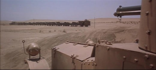 Picture from 'Lawrence of Arabia'  showing an armoured car strafiing an Ottoman Train with Machine Gun fire