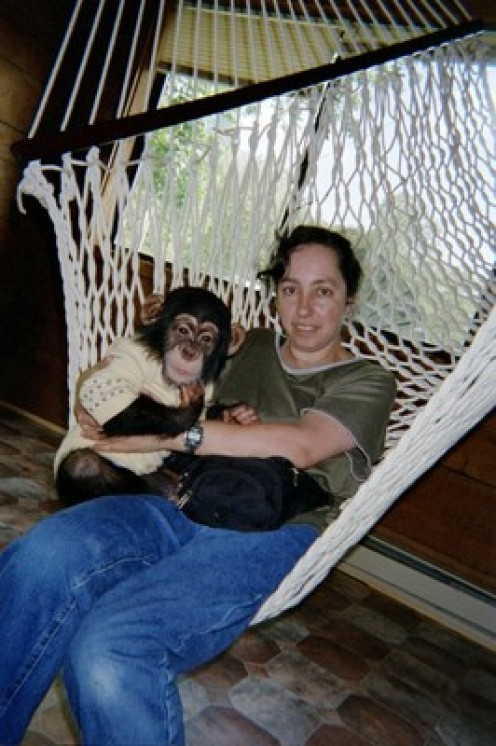 Bow and I on a string hammock that replaced the green and white striped hammock. This one also no longer exists because Bow destroyed it , too, years ago.