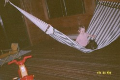 Sword and Teyman on the green and white striped hammock that we no longer have because Bow destroyed it. That carpet underneath the hammock also no longer exists because Bow destroyed it.