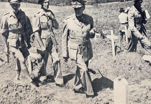 "Smuts examining graves of South African servicemen at Castiglione, Italy, 1945. Image Lean ""One Man in His Time""."