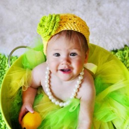 Lovely baby girl in colourful dress