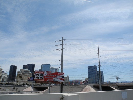 View from the Rio Parking Garage facing the Las Vegas Strip.  As you can see, there is a huge chemtrail mass directly over one of the busiest weekend spots in Vegas, just in time to catch thousands of tourists as they dash to lunch.