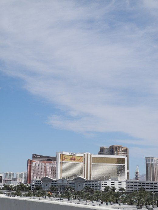 Vegas Strip Chemtrail Loaded Skies shot from the Rio Hotel on Flamingo.  Notice the milky opaque clouds, this is a Geoengineered Cloud Mass after it morphed into a cloud-like formation.  The perfect vacation to bring home a laboratory created flu.