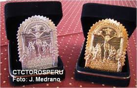 Silver and gold scapularies from the Lord of Miracles bullfighting fair