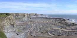Erosion caused by sea waves.