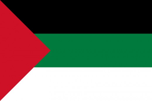 The flag of the Arab Revolt, a WWI military effort against the Ottomans that was largely inspired by Britain and it's interests.  Unsurprisingly, the flag was designed by Britain.
