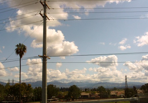 Clouds with billowy plumes look like pieces of cotton I could jump on.  Oh, the beauty of Southern California cloud filled skies!