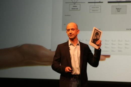 Amazon CEO Jeff Bezos shows off the Kindle DX (Credit: Sarah Tew/CNET News)  Read more: http://news.cnet.com/8301-17938_105-10234355-1.html#ixzz1I3BjMWkn