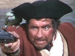 Robert Newton as Long John Silver, who I might possibly not have run away to sea with!