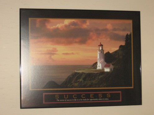 Lighthouse picture in my office. Quote on Success