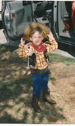 """Howdy Pardner..I think there's a snake in my boot...""  My son as Cowboy Woody, Halloween 1998."
