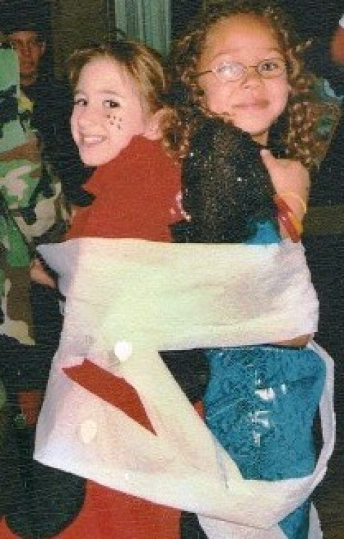 "My daughter and a friend playing the ""Mummy Wrap"" game.  Halloween 2003"