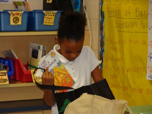 "A student ""shopping"" for books at her level."