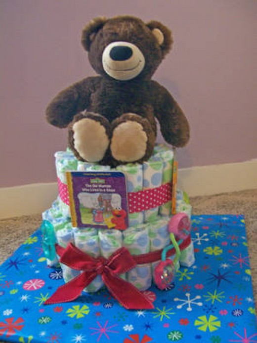 Making a baby shower diaper cake is time consuming, but allows for greater personalization opportunities.
