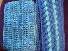 2 scarves I made to donate to special Olympics. They both use the same yarn and the same hook sizes. The one on the left is a triple crochet repeating stitch with the two yarns held together as I crocheted. The right one is a bobble stitch.