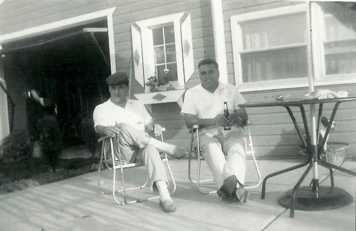 Neighborliness (My husband's dad with hat on and neighbor)