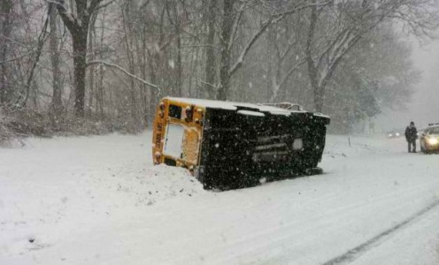 State police respond to an overturned school bus on the Merritt Parkway in Stamford, Conn. on Friday, Jan. 7, 2011. Photo: Contributed Photo / Stamford Advocate Contributed