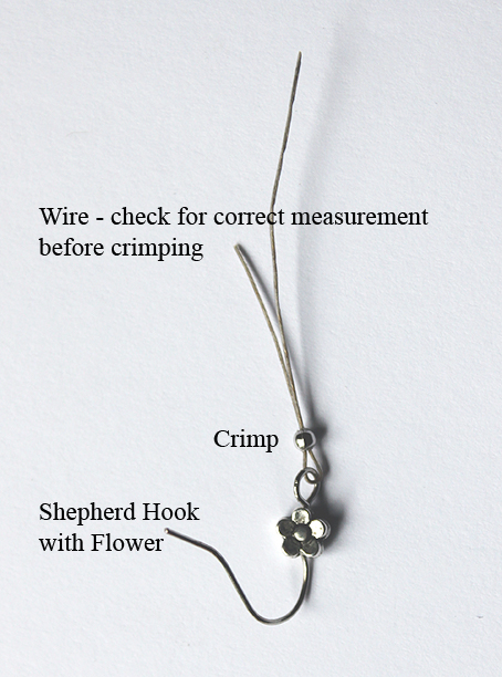 Step 1 Feed wire through Hook and both ends through crimp.