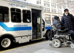 A woman needed the lift to get on the Access-A-Ride Bus.