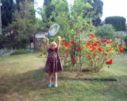 This is Raymonde practising her serve in the garden.