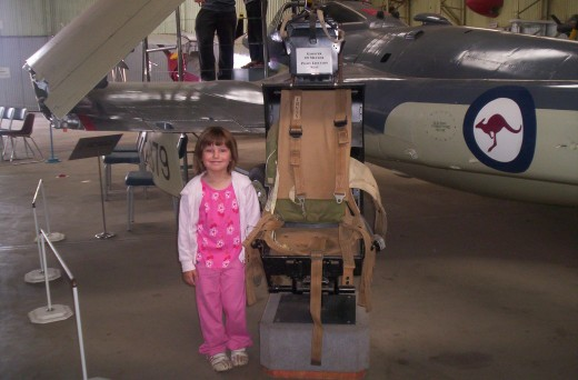 My Daughter standing near an ejection seat.