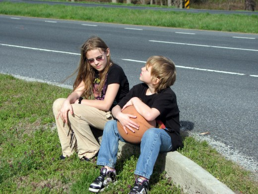 My two youngest children, Sarah and Tommy, sit on the curb as I stop to take photographs on our way to the store. The warm weather seemed to have a very calming affect on my children. I like that.