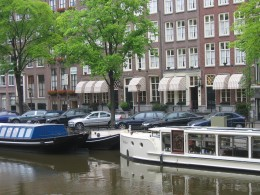 Hotel Estherea (with tan/white striped awning) from across the Singel canal.