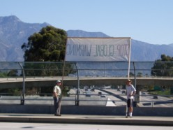 Protesting with signs over the CA 210 freeway. Letters have to be big to be read from far away.