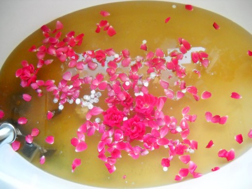 Tea bath with rose petals.