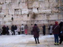 That's me in the long gray raincoat on the right saying a prayer at the Wailing Wall in Jerusalem.