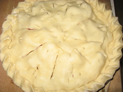 Cut holes in the crust to allow steam to escape while the pie bakes.