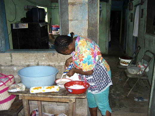 Woman making bread in her home.