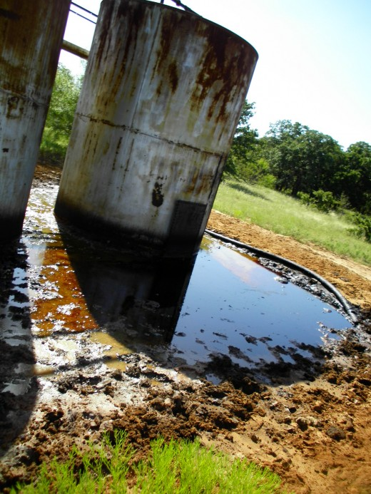 A leaking tank is classified by the EPA as an ongoing active Oil Spill either in a contained area or not.