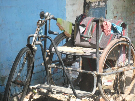 A broken down rickshaw.