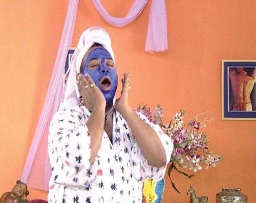 Funny woman/man applying blue face pack - from movie The Pink Mirror