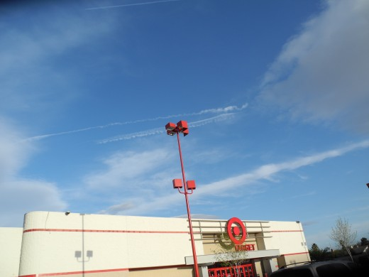 Perfect Timing!  A couple of Chemtrail Pilots are busy laying lines of Chemicals just before hundreds of families will dash into Target for their weekly weekend shopping spree.